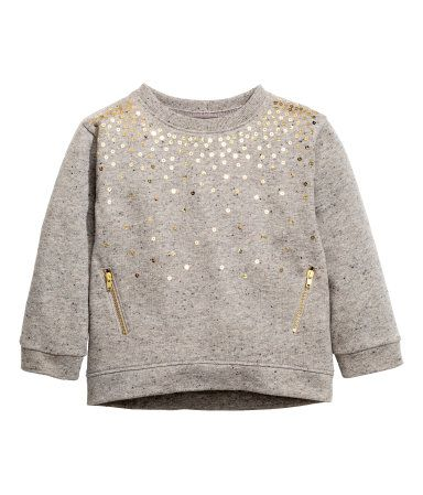 Gray/glittery. Sweatshirt with sequined embroidery at front and ribbing at cuffs and hem. Slightly longer at back.