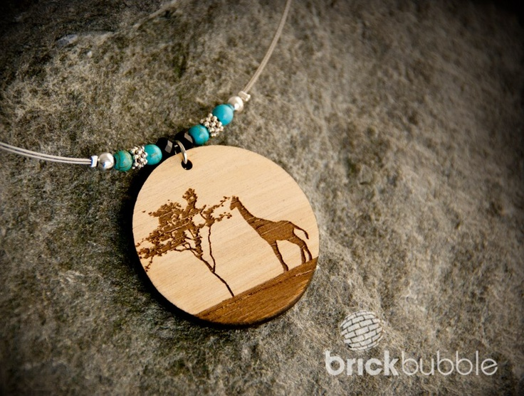 Laser engraved and cut wood pendant. www.brickbubble.ca