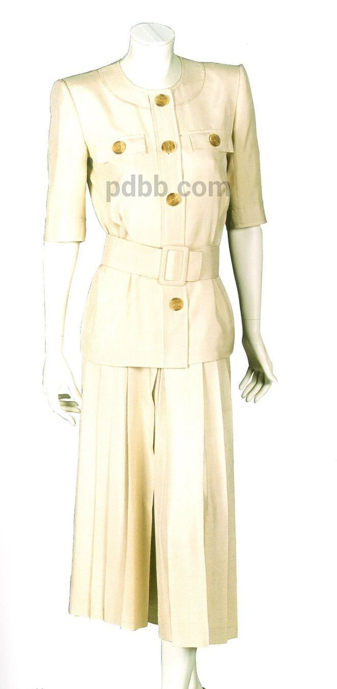 Catherine Walker cotton silk safari style jacket with tortoiseshell buttons, round neckline and wide matching fabric belt with full, pleated culottes to resemble a skirt.