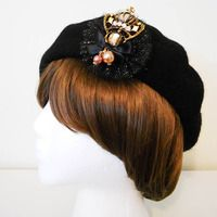 http://thesnowfield.storenvy.com/collections/275219-all-products/products/4072337-gold-royal-crown-beret-pre-order
