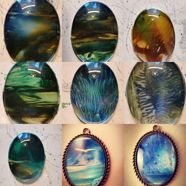 Mini encaustic paintings as pendants under glass cabochon