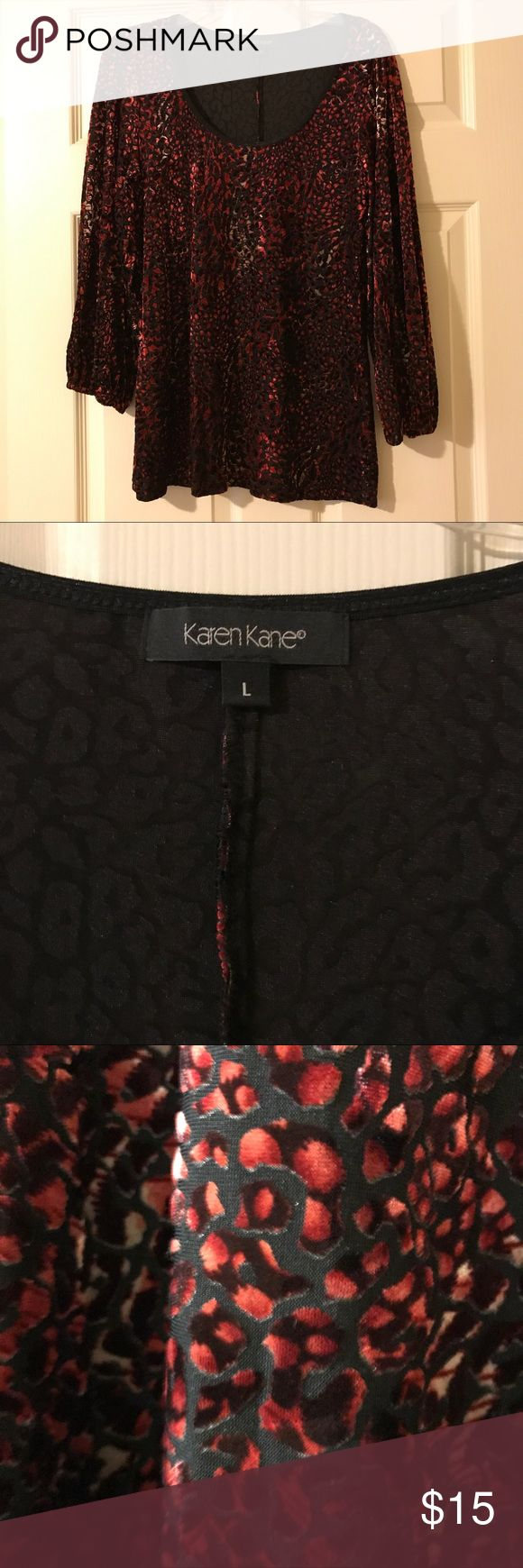 Beautiful Karen Kane tunic Soft velvet like material in red and black.  Sleeves are long with elastic at wrist. Karen Kane Tops Tunics
