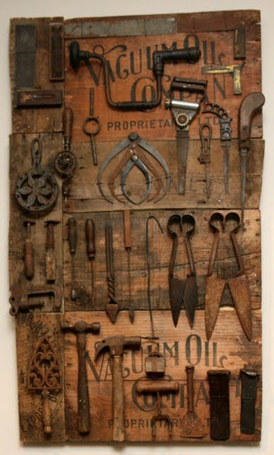 Using vintage crate and advertising boards as a backdrop for hanging tools makes them look like a special collection or display.