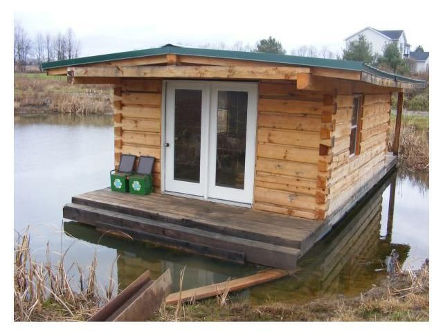 tiny floating log cabin - Small Houseboat