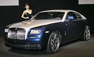 """Rolls-Royce's new coupe-style super luxury car, the Wraith: """"The Wraith is the car that will drive the perceptional change of Rolls-Royce,"""" Paul Harris, Asia Pacific Regional Director of Rolls-Royce Motor Cars, said during a launch event at Grand Hyatt Seoul. """"(We will target) a younger and more dynamic audience. The much more powerful car will be much more appealing."""""""