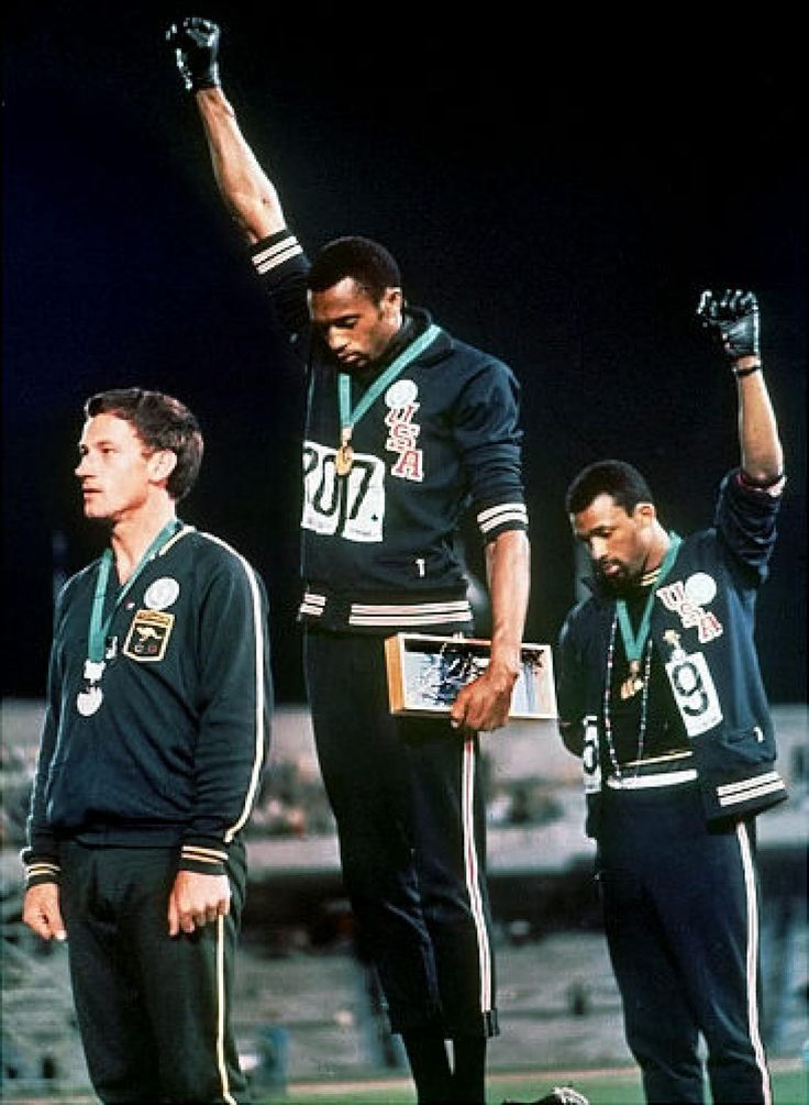1968 Medal winners Tommie Smith and John Carlos raise their fists in protest on the victory stand at the Mexico City Olympics. In retrospect, it seems like a fairly mild gesture in light of the violence and tension that characterized American race relations that year. But the image shot across American TV screens like a bolt of lightning.