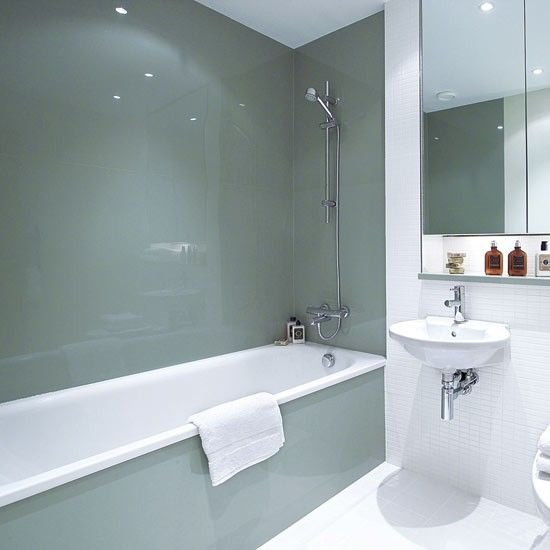 Modern bathroom with sleek green glass panels and white fittings