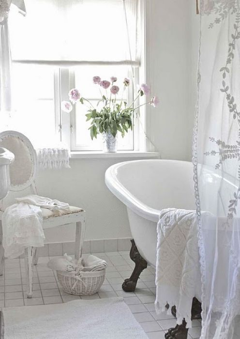White and Romantic Bathrooms - great ways to give your bathroom a facelift without the expense of a bathroom remodel.