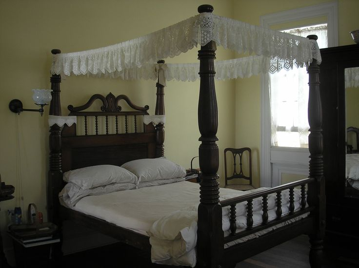 This West Indian mahogony four-post canopy bed is one of the true masterpieces of this beautiful home. Every inch of this bed was hand carved by local craftsman here in the Virgin Islands.