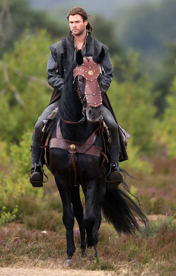 In the newest pictures from the set of The Huntsman, we see the Sexiest Man Alive in action riding a horse.