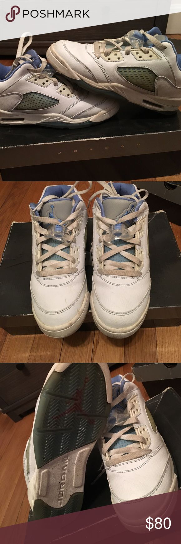 Jordan 5's Jordan low retro 5's in great condition hardly worn. Laces are a little dirty but just replace em and they will b like new. Can't find in stores. White and North Carolina blue. Shoes Sneakers