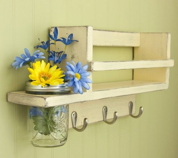 You could make this easy out of pallets, old door knobs or faucet knobs!