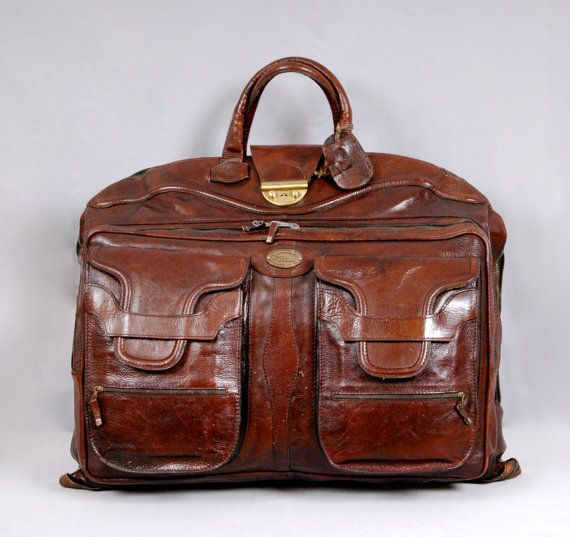 A beautiful 1970s 100% leather suit carrier luggage with original key. Ja Ja Bologna. -- Anyone else want to get this for the man in their life, just so they can borrow it all of the time? ;)