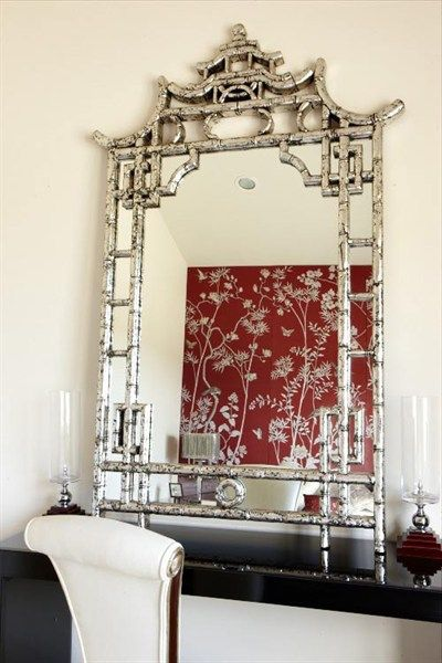 Fabulous in antiqued silver chinoiserie style mirror with a pagoda.