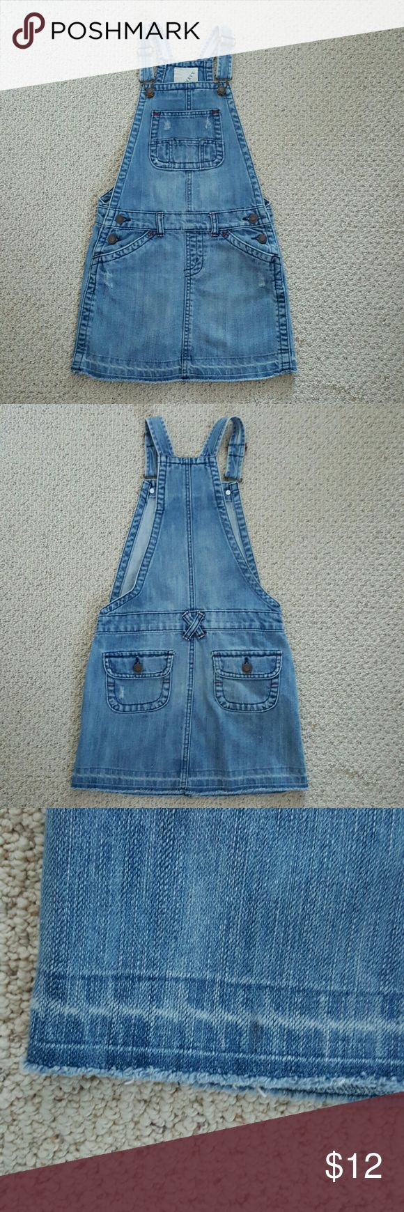 Distressed Lt. Blue Wash Denim Overalls Dress 100% Cotton  Length: 12 inches from waist to hemline  Old Navy's overalls dress is intentionally distressed and the hemline is in a cutoff style. (see pic #3) It has adjustable/detachable straps and 2 buttons on the sides of the waist.  Bronze colored signature hardware with 3 pockets in front & 2 covered pockets in the back with red threading accents on pockets and belt loops. Great condition without rips or stains.  *Shipping next day / Bundle…