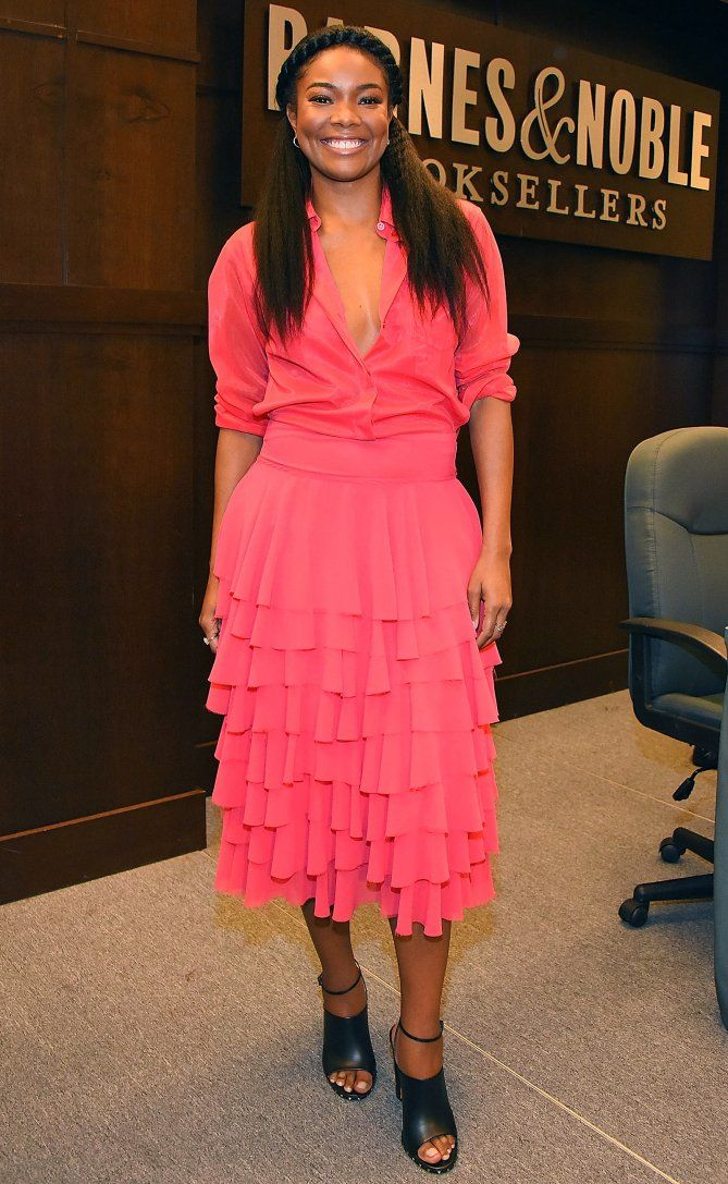 Gabrielle Union in a coral top and ruffle midi skirt