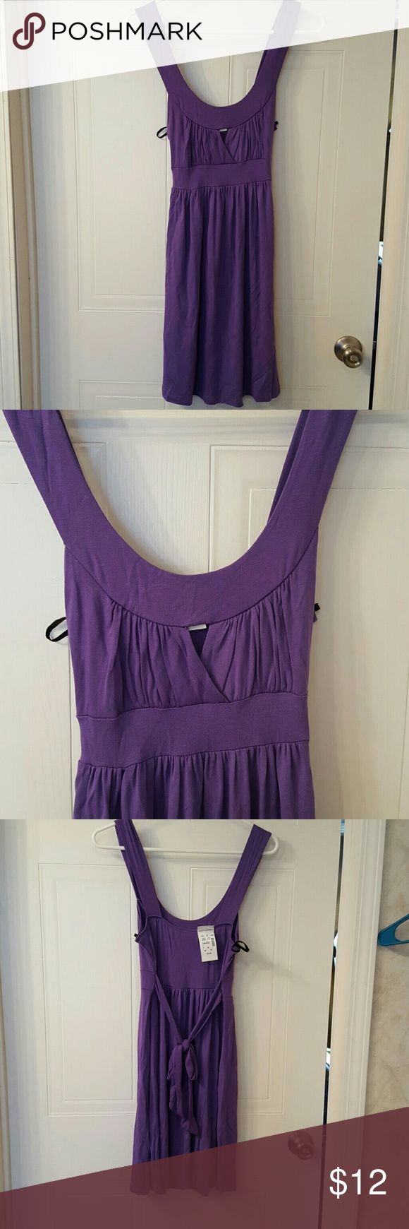 NWT Purple Cutout Dress NWT- Size Medium- Body Central Dress- Purple with scoop neckline and Cutout- Midthigh length- Ties in the back Body Central Dresses