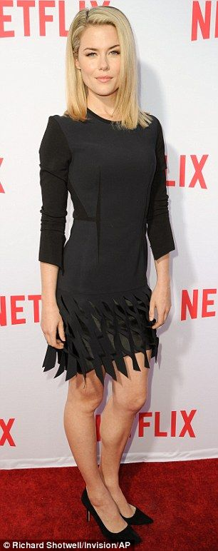 Krysten Ritter wears a slit scarlet dress at Jessica Jones screening