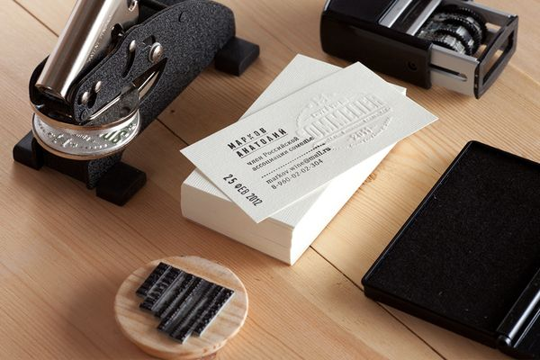 Business cards designed for sommelier Markov Anatoly by Pavel Emelyanov, via Behance -- uses a paper press seal and a rubber stamp