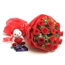 flowers with cute teddy and chocolate