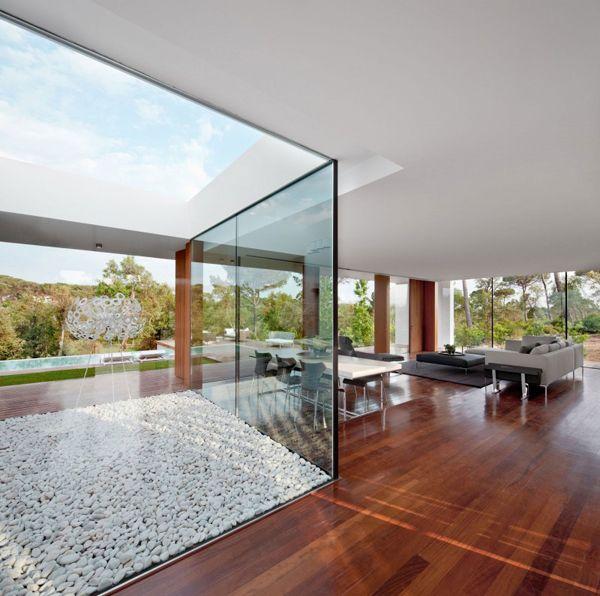 Designed by Spanish studio Josep Camps and Olga Felip, the Villa Indigo for property developer PGA Catalunya Resort is located in Caldes de Malavella