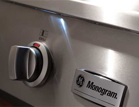 The Monogram professional rangetop has LED task lights strategically positioned above the control knobs for a functional and theatrical touch.
