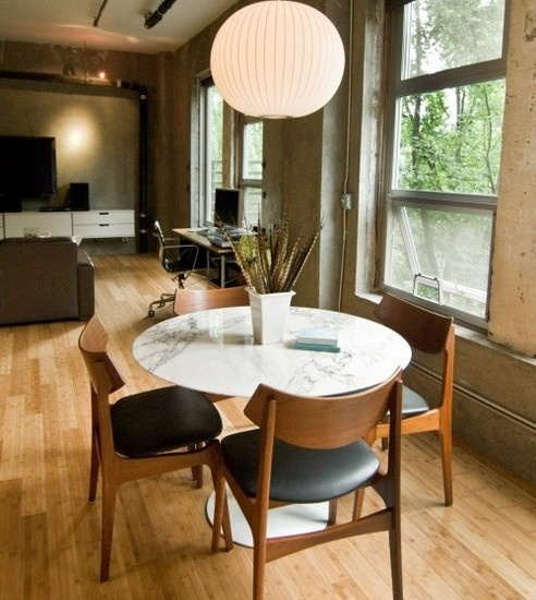 Furniture White Saarinen Tulip Dining Table As Well Soft Black Cowhide Leather Vintage Danish Chairs Also Light Wood Floors Industrial Walls