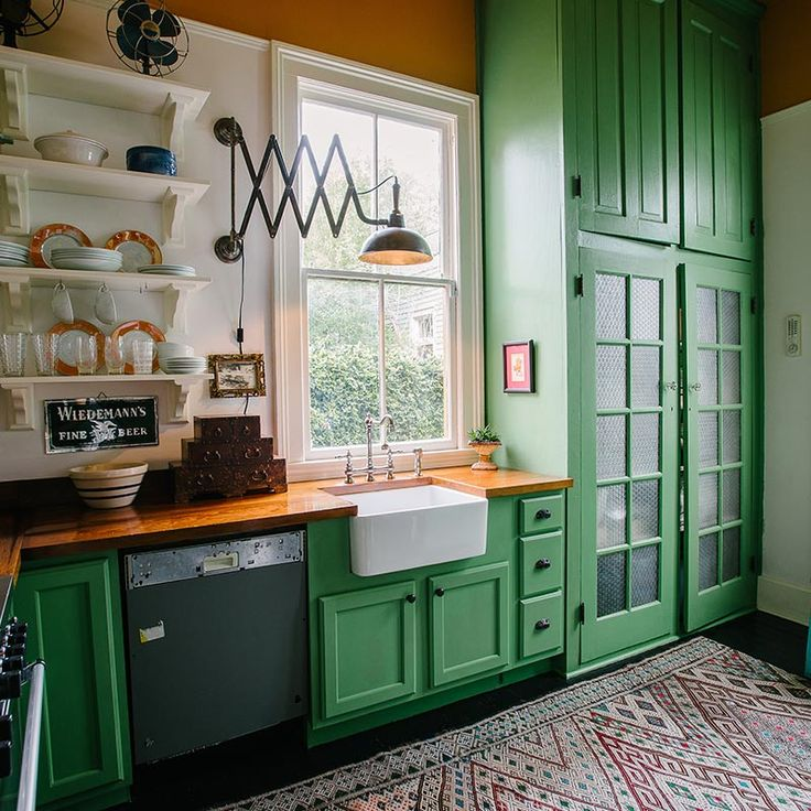 Love the Kelly green colour, farmhouse sink and butcher block cupboards!!!  Add some white subway tile as a backsplash and you have the perfect kitchen.