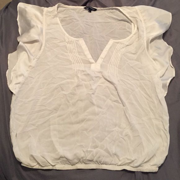 White short sleeve shirt White short sleeve shirt with V Cut and ruffled sleeves. Sorry about the wrinkles! Just unpacked from moving American Eagle Outfitters Tops