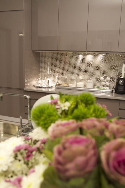 Suzie: Ana Antunes - Chic kitchen with glossy taupe lacquer kitchen cabinets, metallic mosaic ...