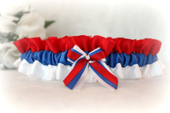 Beautiful handcrafted Serbian flag garter. This garter can be done in many other colors to match your bridal party, a different country flag colors or in your favorite sports team colors. The possibilities are endless!  PLEASE READ ABOUT SIZING: The sizes you choose from are leg measurements. I will make the adjustment so it (they) will fit comfortably.  PLEASE READ THIS FOR PRODUCTION TIME: I have an average of 2 weeks turn around. Please leave me the date of your wedding/special occasi...