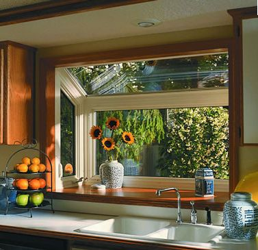 greenhouse windows for kitchen | Replace your window with a greenhouse window. It will bring in more ...