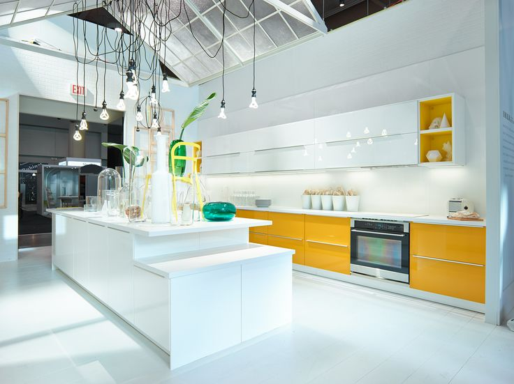 The bright, beautiful IKEA kitchen with RINGHULT high gloss white cabinets with JÄRSTA yellow accents.