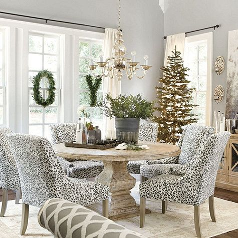 leopard print chairs + rustic pedestal + glass chandelier