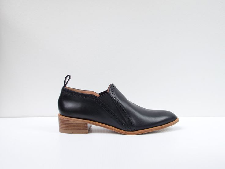 XizzyRobert ClergerieBlack leather double gusset high cut shoe with punchout trim$930