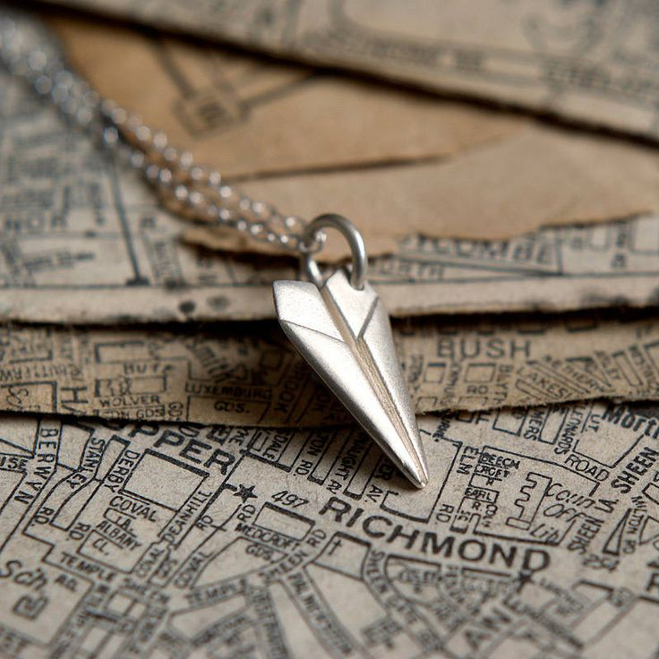 This quirky paper plane necklace is made from sterling silver and comes with a personalised message card. An origami style plane makes a lovely gift. £29.00