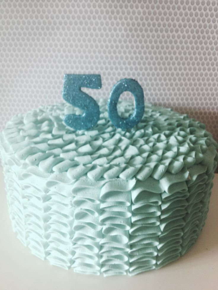 Blue ruffle cake for a 50th www.crumbsbakery.com.au
