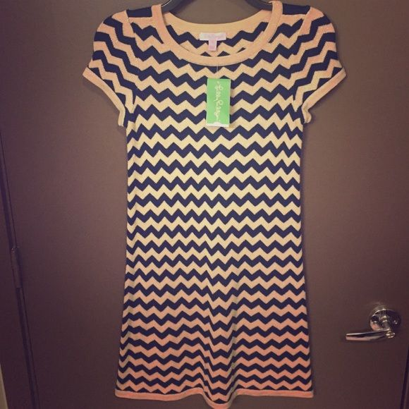 "Lilly Pulitzer navy gold chevron ""Santana"" dress BRAND NEW WITH TAGS Lilly Pulitzer navy gold chevron ""Santana"" short sleeve sweater dress. The gold has some sparkle to it. BEAUTIFUL dress. Size small Lilly Pulitzer Dresses Mini"