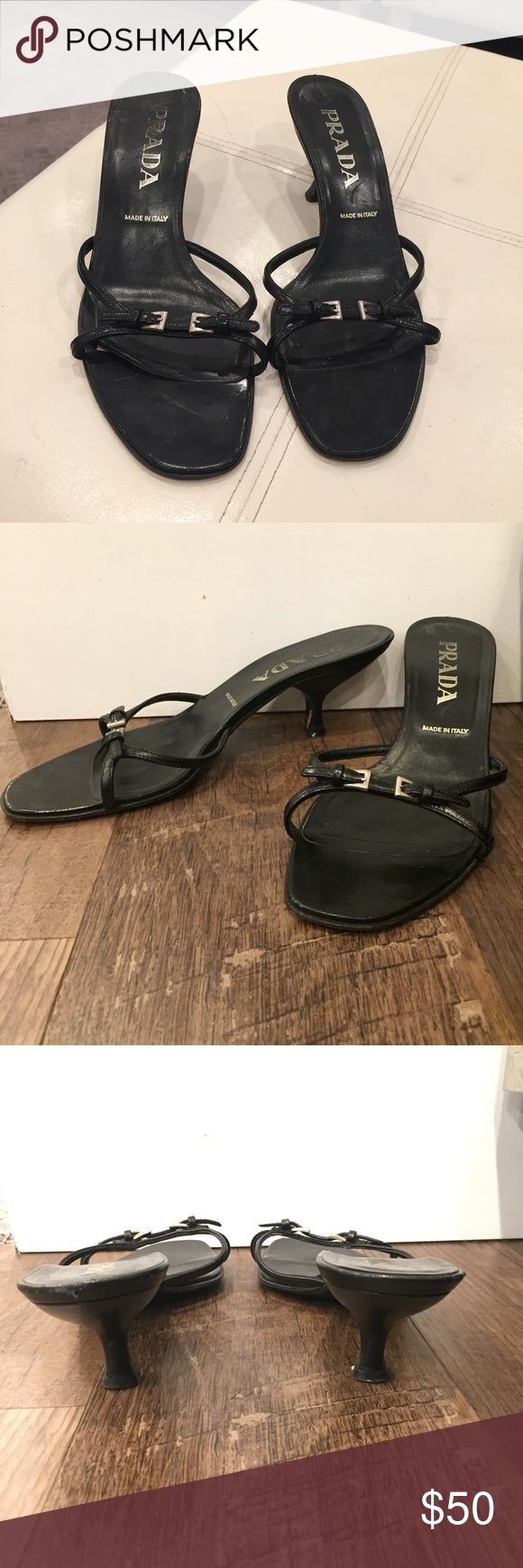 Size 37 (7 US). Black Prada kitten heel sandals. Very cute black Prada kitten heels.  These were previously very loved.  They are in good shape but NOT great shape.  They could use a little TLC.  I've tried to show all of the wear and scuffs but it's hard to show on black items.  They're low and comfortable and definitely have more miles left in them.  Let me know if you want more pics. Make an offer.  Thanks! Prada Shoes Sandals