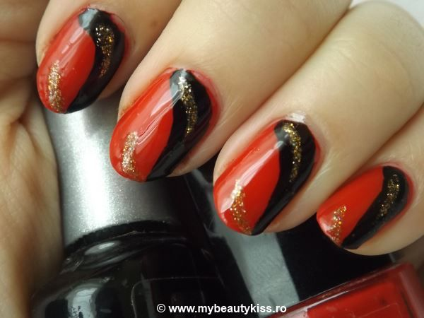 Nail Of The Day -  Red, Black and Gold http://www.mybeautykiss.ro/NOTD36_RedBlackAndGold.php  #nails