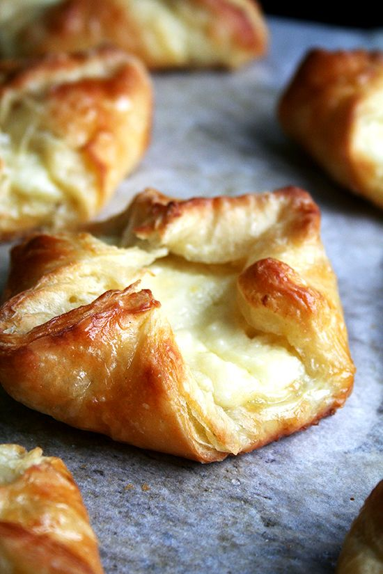 just-baked cheese danish. The food processor is used to cut the butter into the dry flour mixture. That mixture is put into another bowl where the wet ingredients are added and mixed together. The whole thing is then pujt in the fridge to rise overnight.
