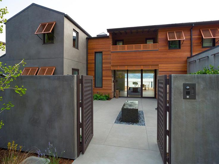 Exterior color palette. Cool gray stucco blends with warm wood siding, offering balance and giving a hint at the home's modern interiors.