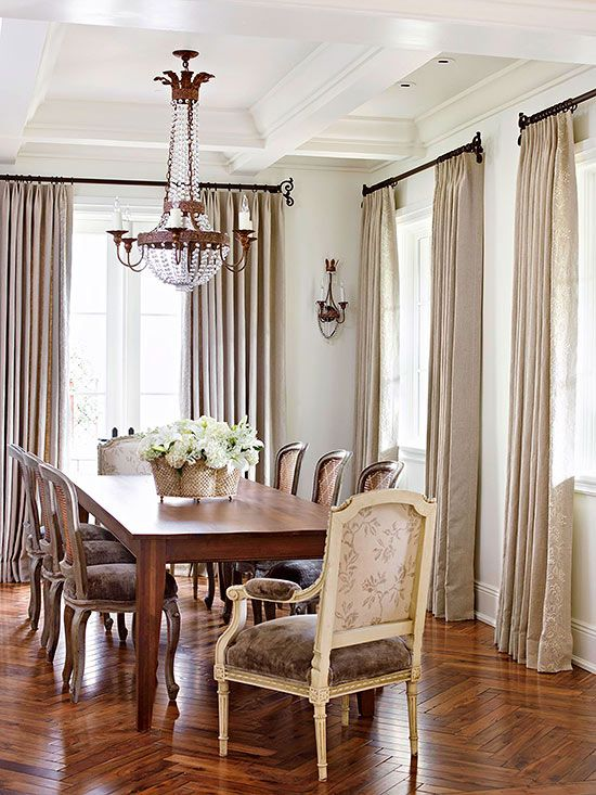 A thoughtful balance is achieved in country French style that provides an elegant stage for casual living. To accomplish this, dress the room with French influences, such as full-length draperies, rich wallpapers or paint finishes, and formal fabrics. Then fill the space with livable furnishings, such as this generous, farmhouse-inspired dining table, to entice large gatherings of family and friends.