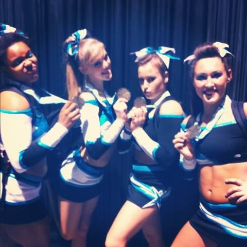 Maddie Gardner winning Gold at Cheerleading Worlds - follow cheerleading news and blog on http://www.cheercoach.net/profiles/blog/list