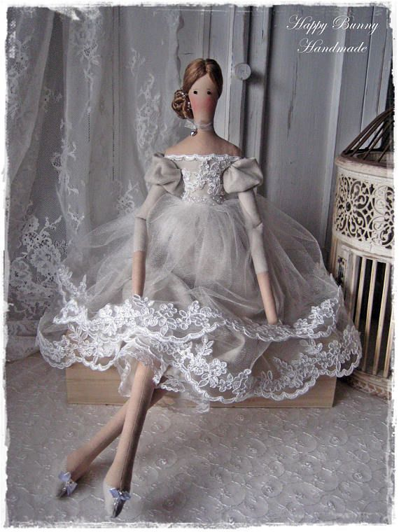 This handmade doll is my interpretation of a Tilda doll pattern. The doll will be a unique and unusual gift or decoration of the house! The doll is wearing a gray dress made from linen, tulle, lace and decorated with pearls, ribbon...Below dress she is wearing panties. The doll