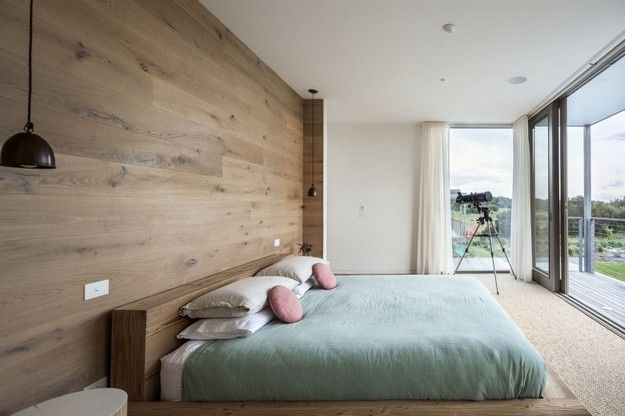 Timber bed surround and feature wall with loads of windows and hanging bedsides :)