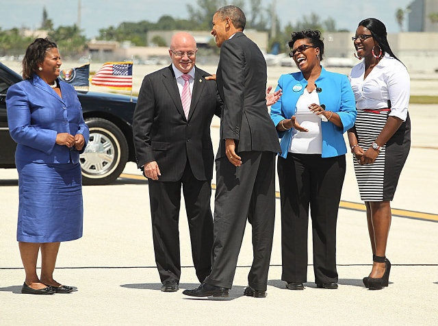 #24 Sept. 20, 2012 President Obama grilled on failed immigration promise, consulate attacks    Miami Dade College President Eduardo Padron share a light moment as the president arrives at Miami International Airport. C.W. Griffin / Miami Herald Staff