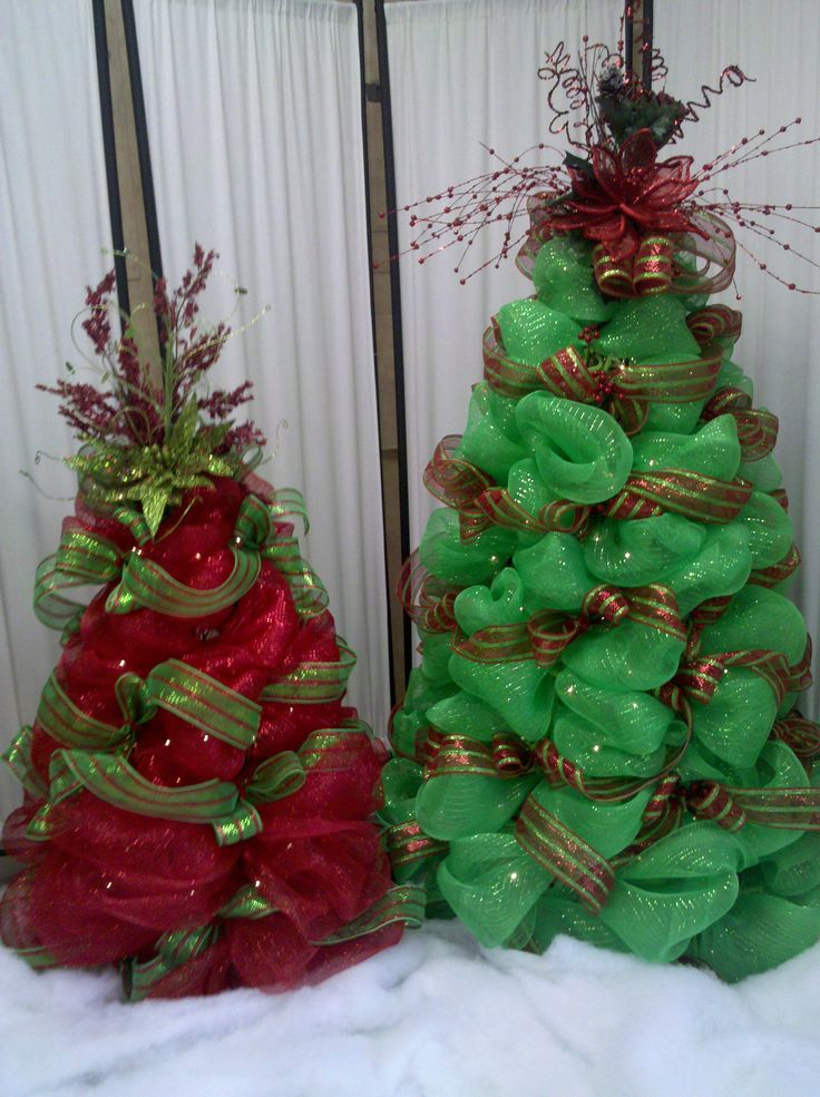 Deco mesh Christmas trees.  Cute idea.  I could use tomato cages and add lights.