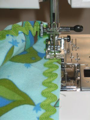 ric rac- how to sew it into the edge of a baby blanket (picture just shows first step)