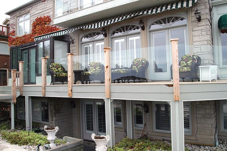 This low maintenance deck was built by Hickory Dickory Decks using tempered glass  and cedar posts for the clear view rail system. Go to www.decks.ca for thousands more deck pictures.